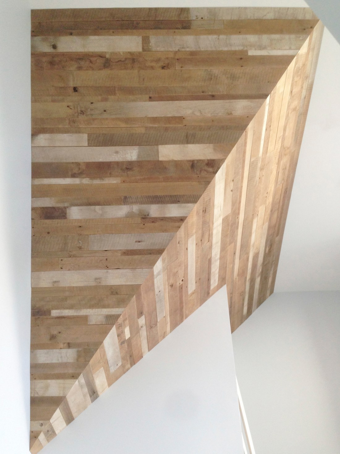 Geometrical ceiling treatment finished with hand prepared barn wood