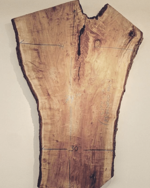 Large Maple slabbed lumber with dimensions written on figured crotch and cream background