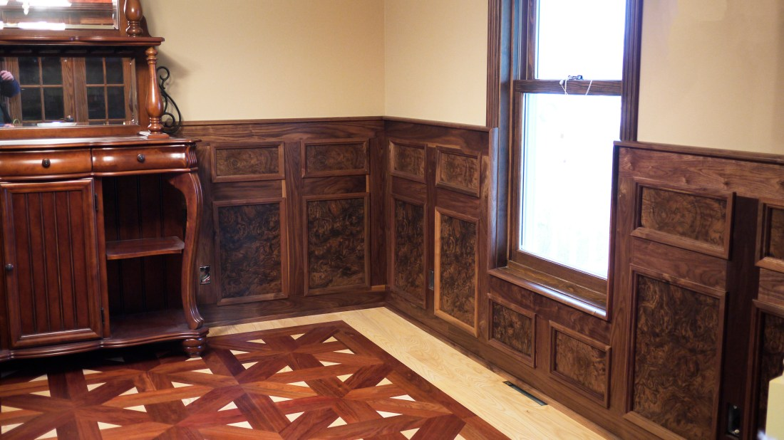 Walnut burled panel and laced wood flooring by skilled craftsman
