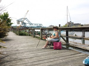 My mother the artist on the dock.