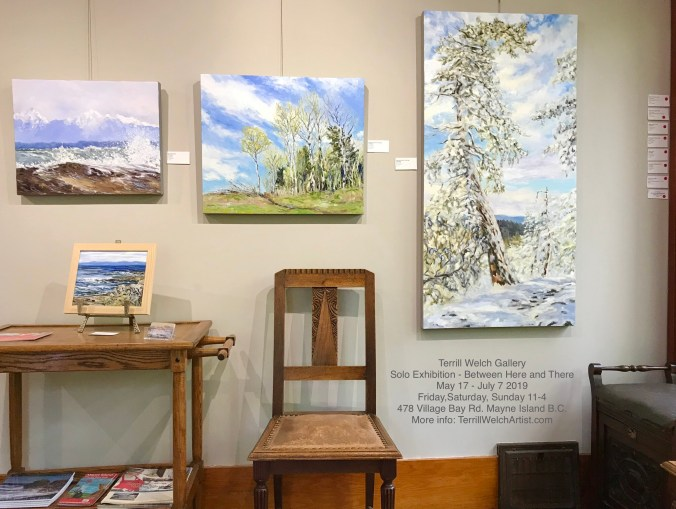 art gallery with contemporary impressionist landscape paintings of trees in spring and winter with snow and a seascape painting