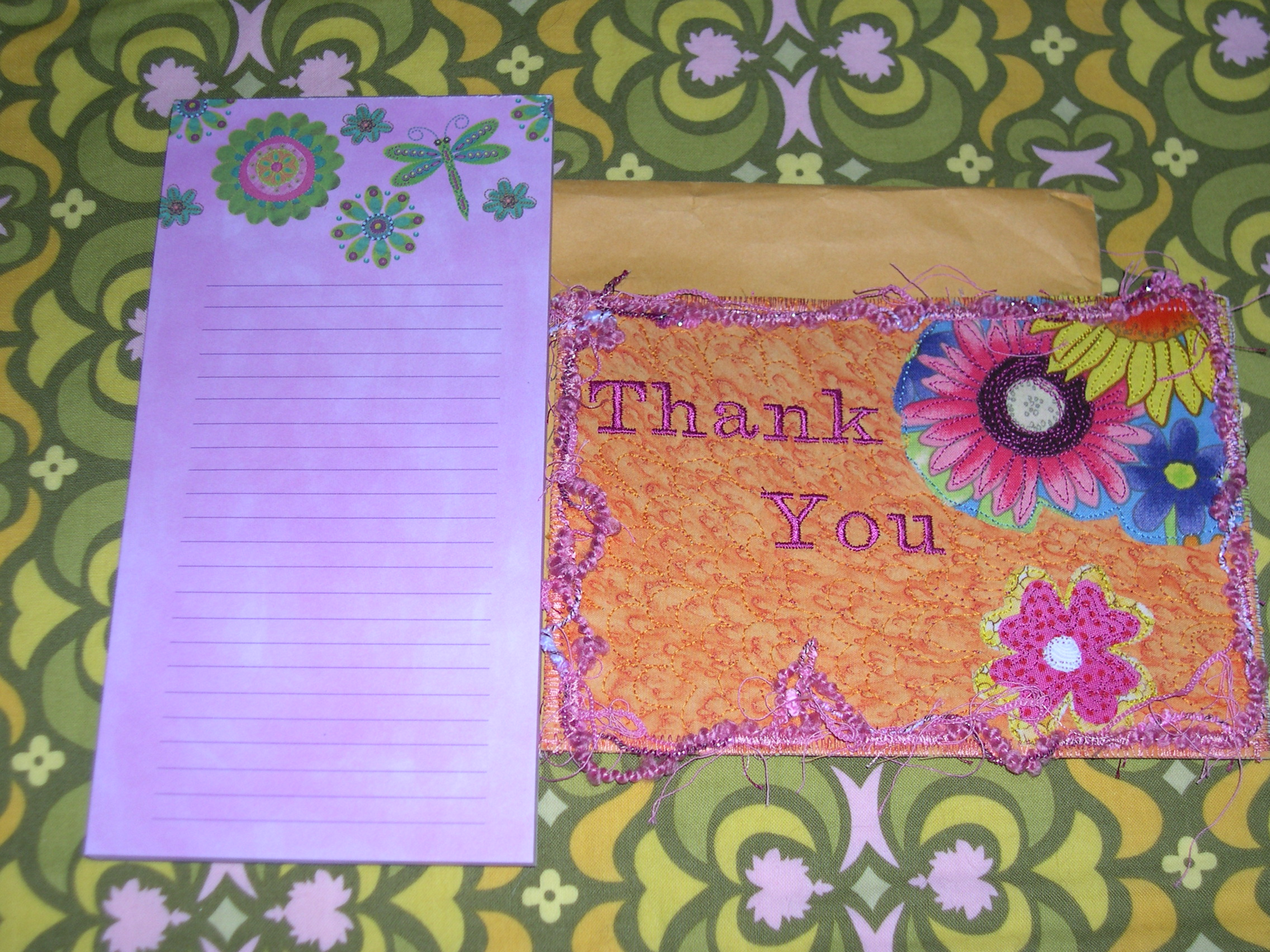 notepad and postcard
