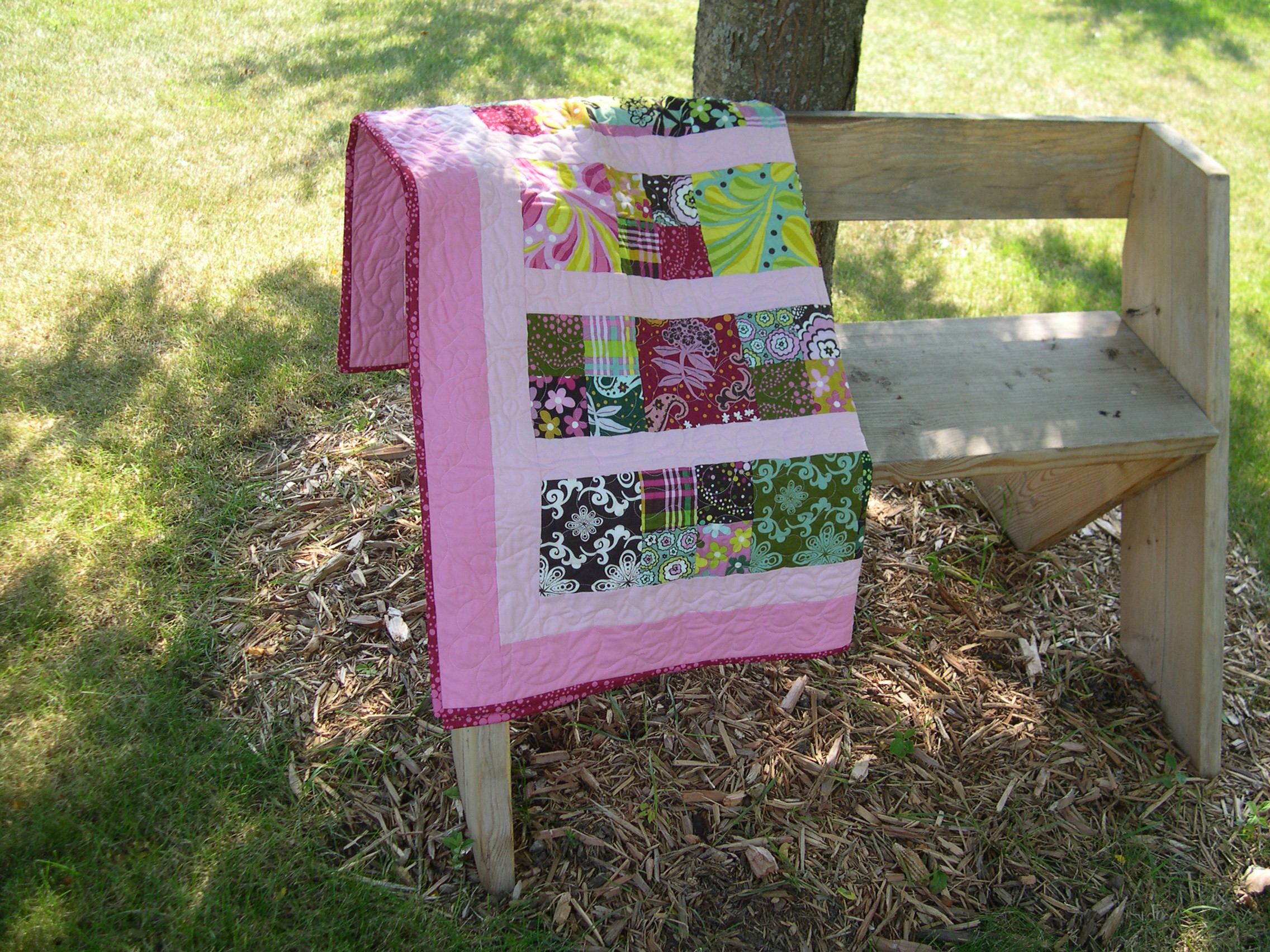 candy quilt on the bench