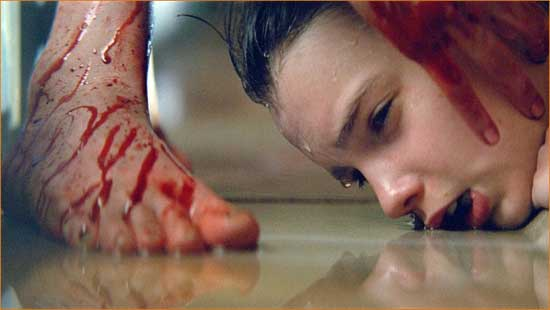 "Abby (Chloe Moretz) and Owen (Kodi Smit-McPhee) bond bloodily in ""Let Me In""."