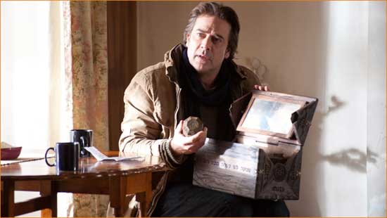 """Clyde (Jeffery Dean Morgan) rummages through his daughter's box in """"The Possession""""."""