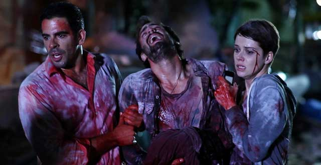 "The Gringo (Eli Roth) and Monica (Andrea Osvárt) lend Ariel (Ariel Levy) a hand in ""Aftershock""."