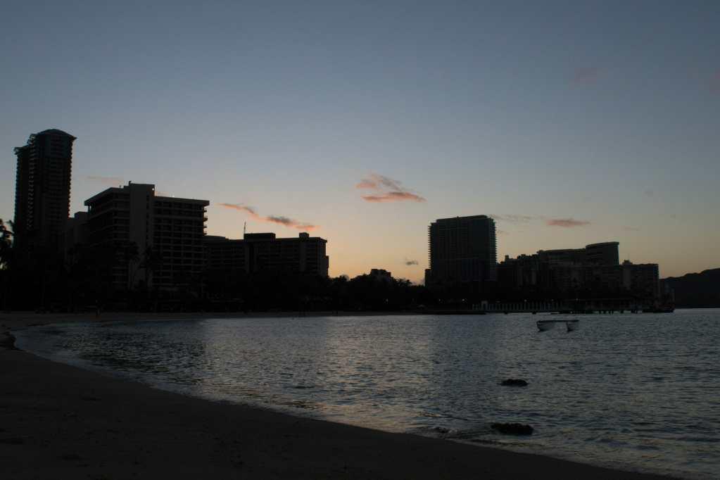 Sunrise looking back toward Waikīkī at Kahanamoku Beach