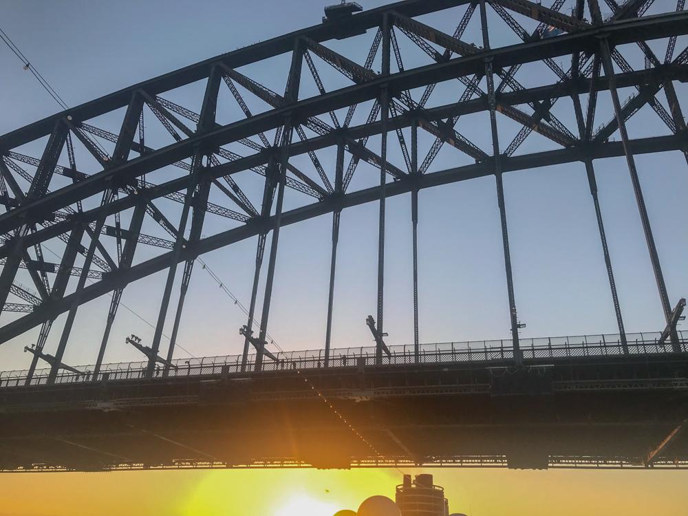 On the far side of the Harbor Bridge