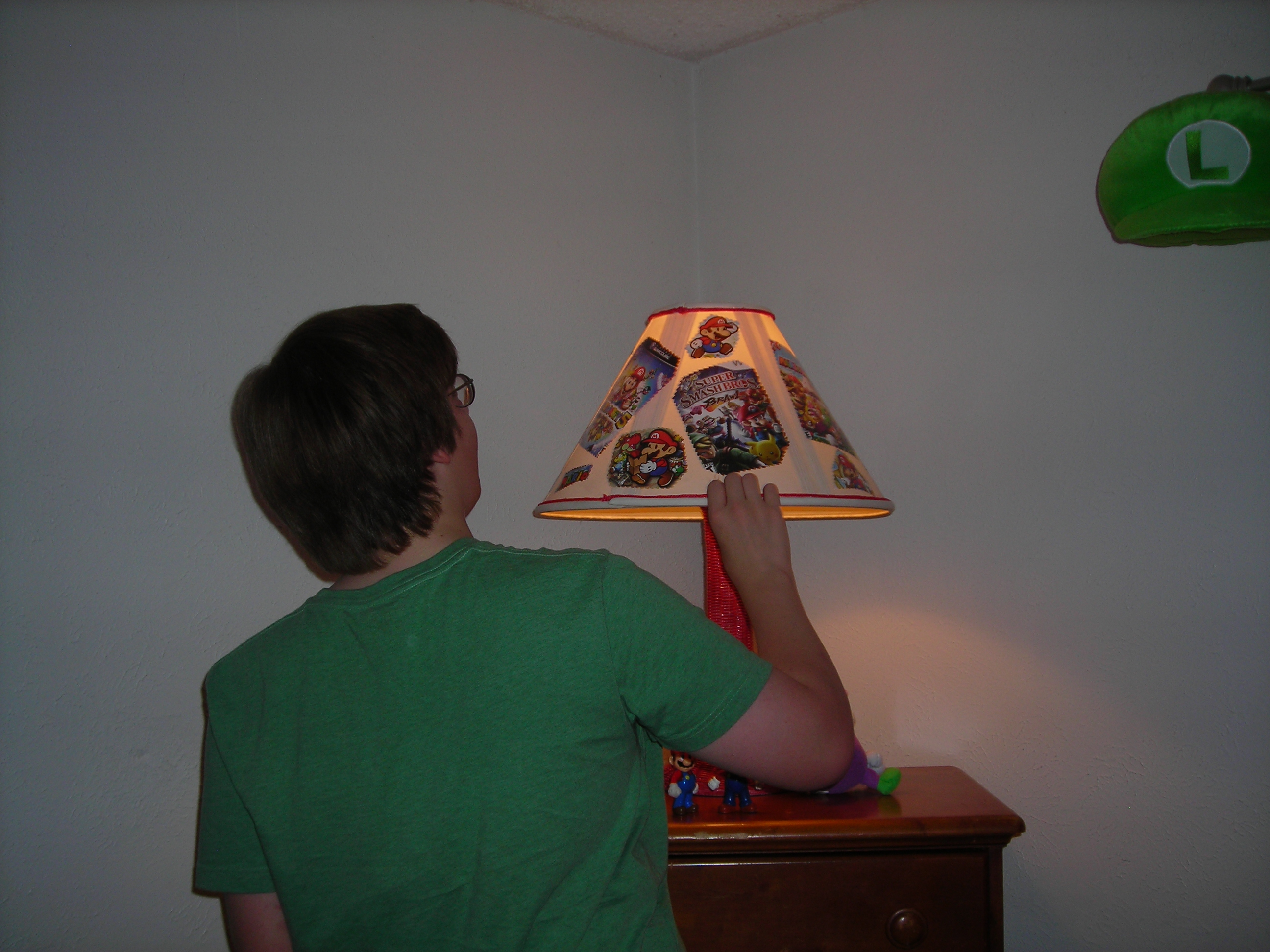 Matt checking out the lampshade. Uh, Mom. Did you use my video game covers?!?!