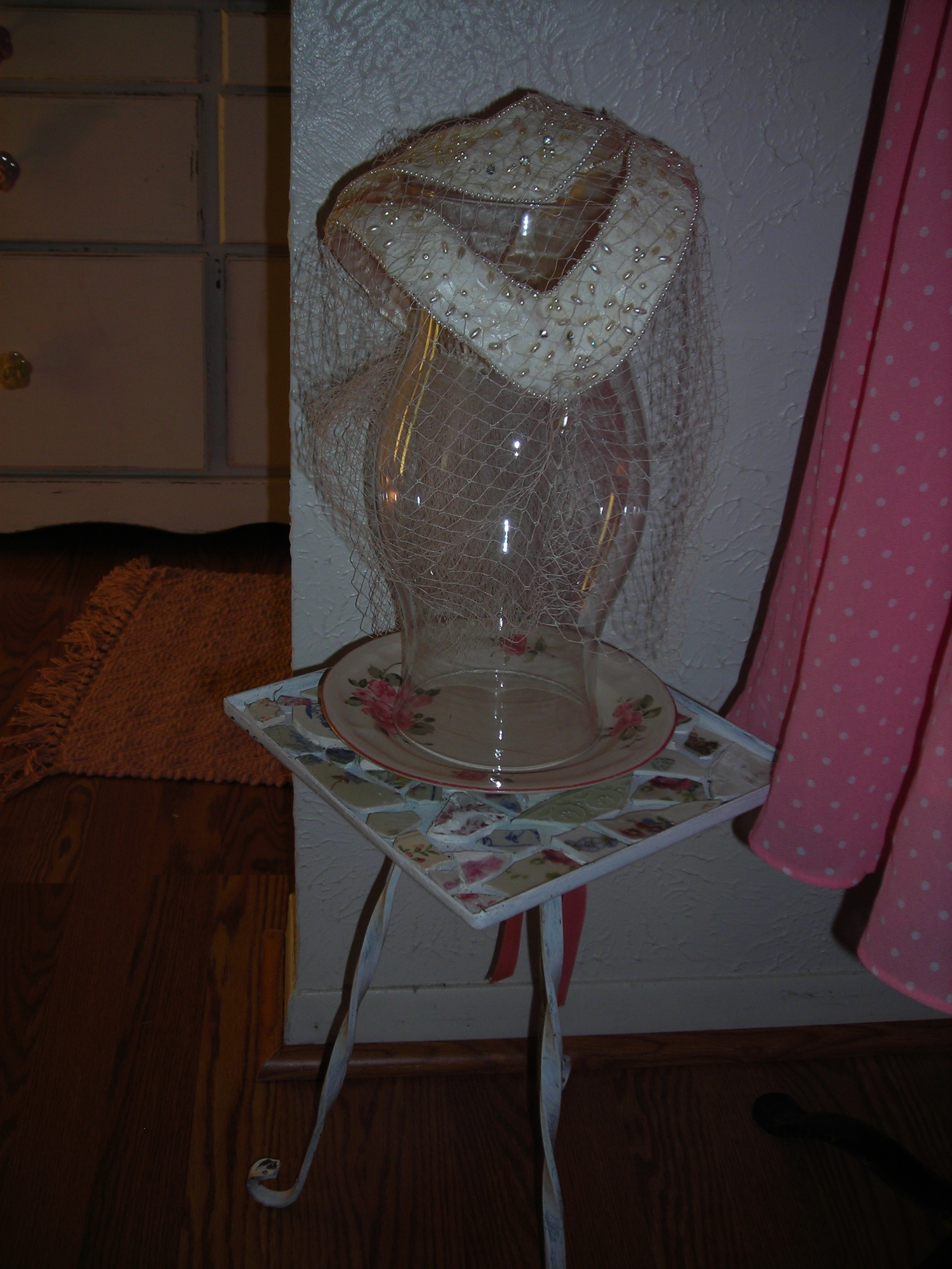 love this frilly hat ... planted her on a glass shade and rosy plate