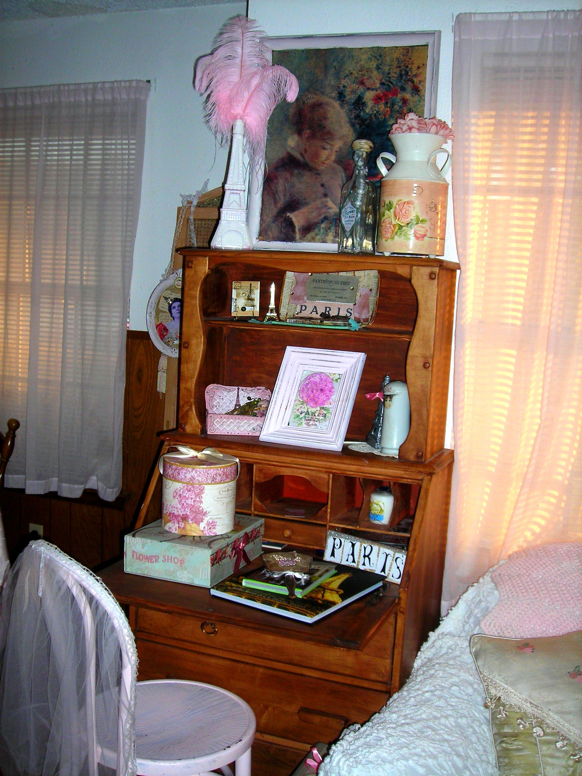 vintage secretary with paris-themed items