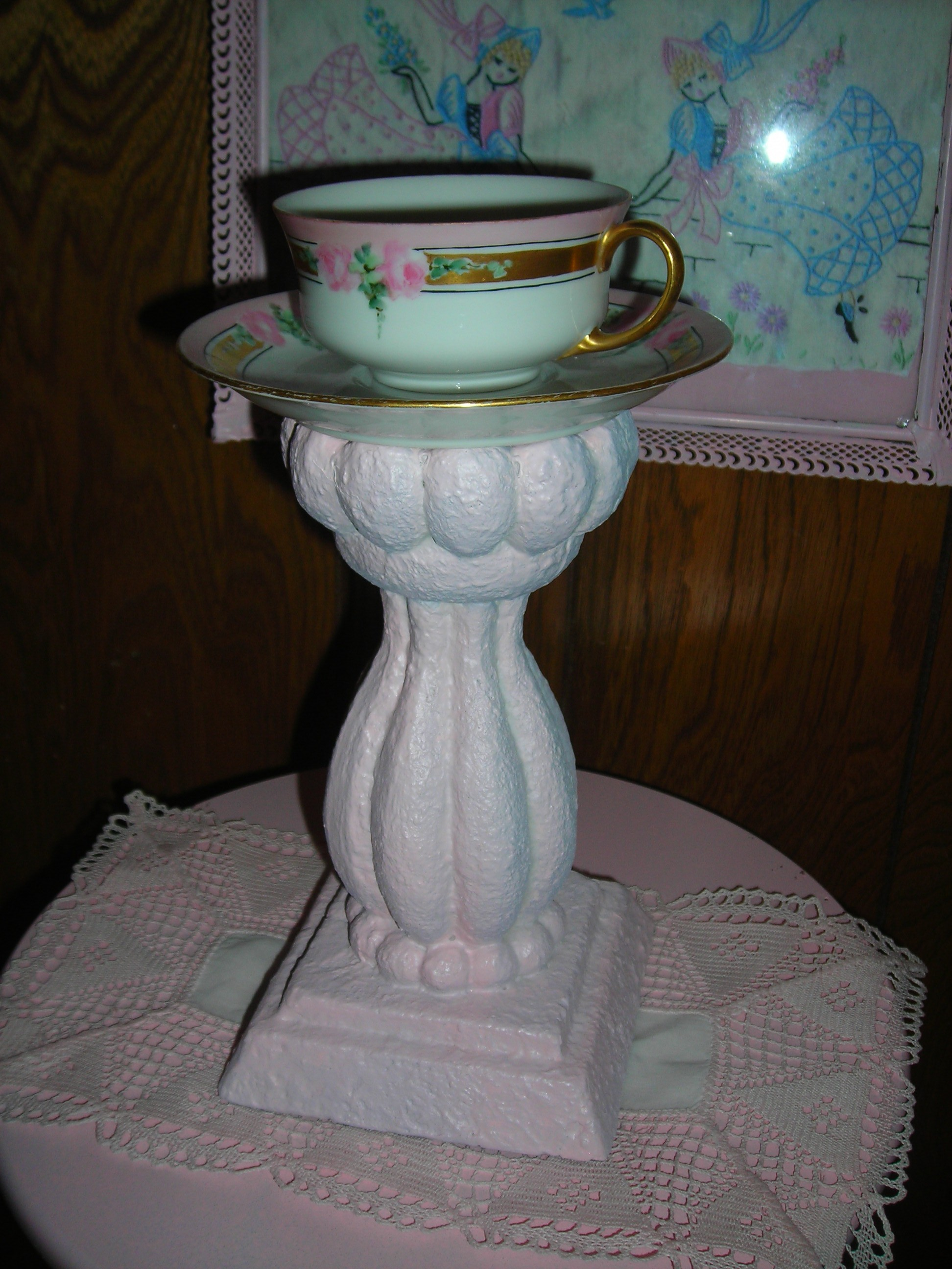 this was an UGLY, nasty candlestick bought at a yard sale recently. a dip of pink paint and she's lovely. esp with a sweet tea cup and saucer on top!