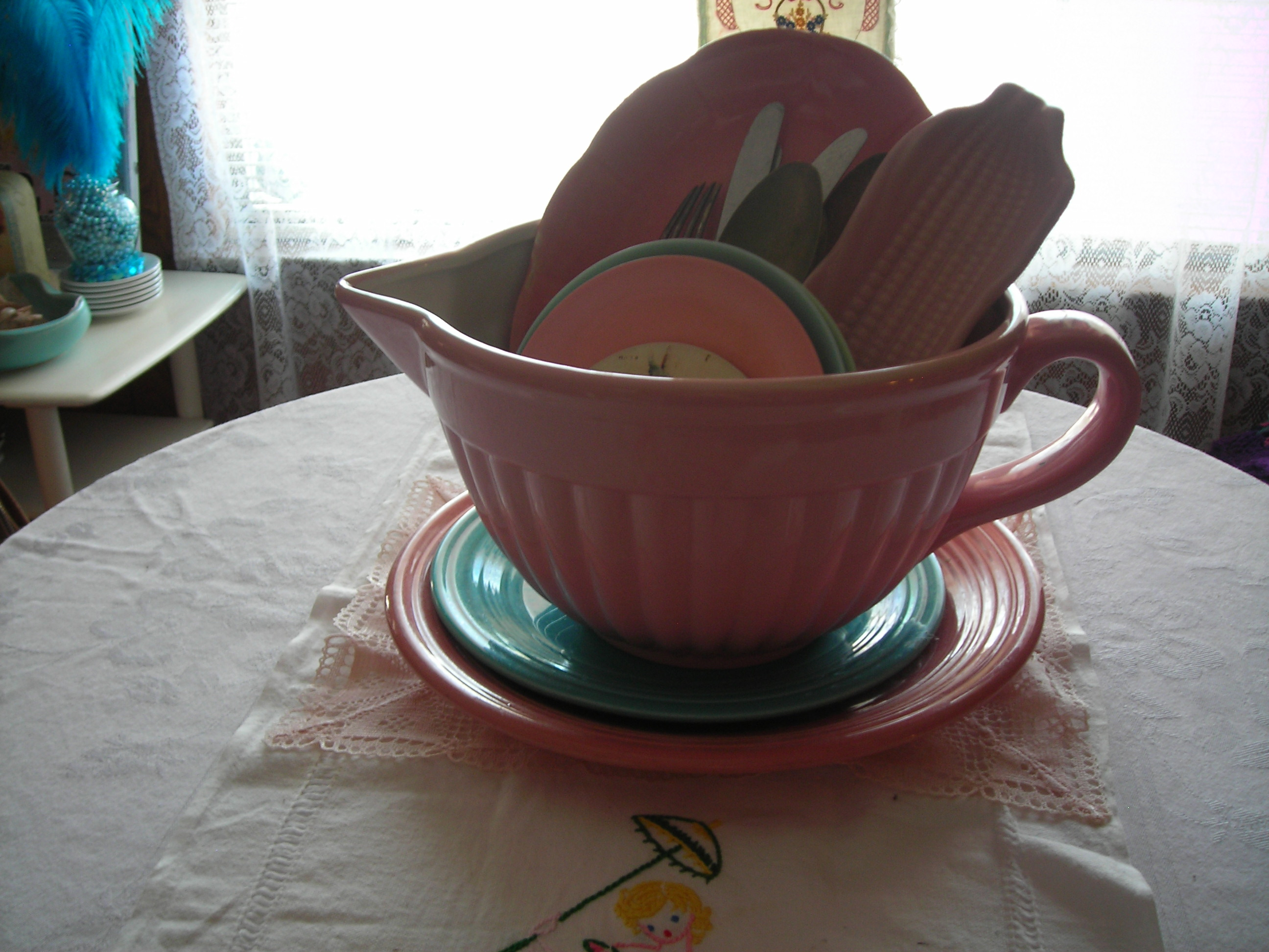here's my pride and joy from the MoMA gift shop ... sweet pink batter bowl. i filled it with old stuff and am using it as a centerpiece for my b'fast table