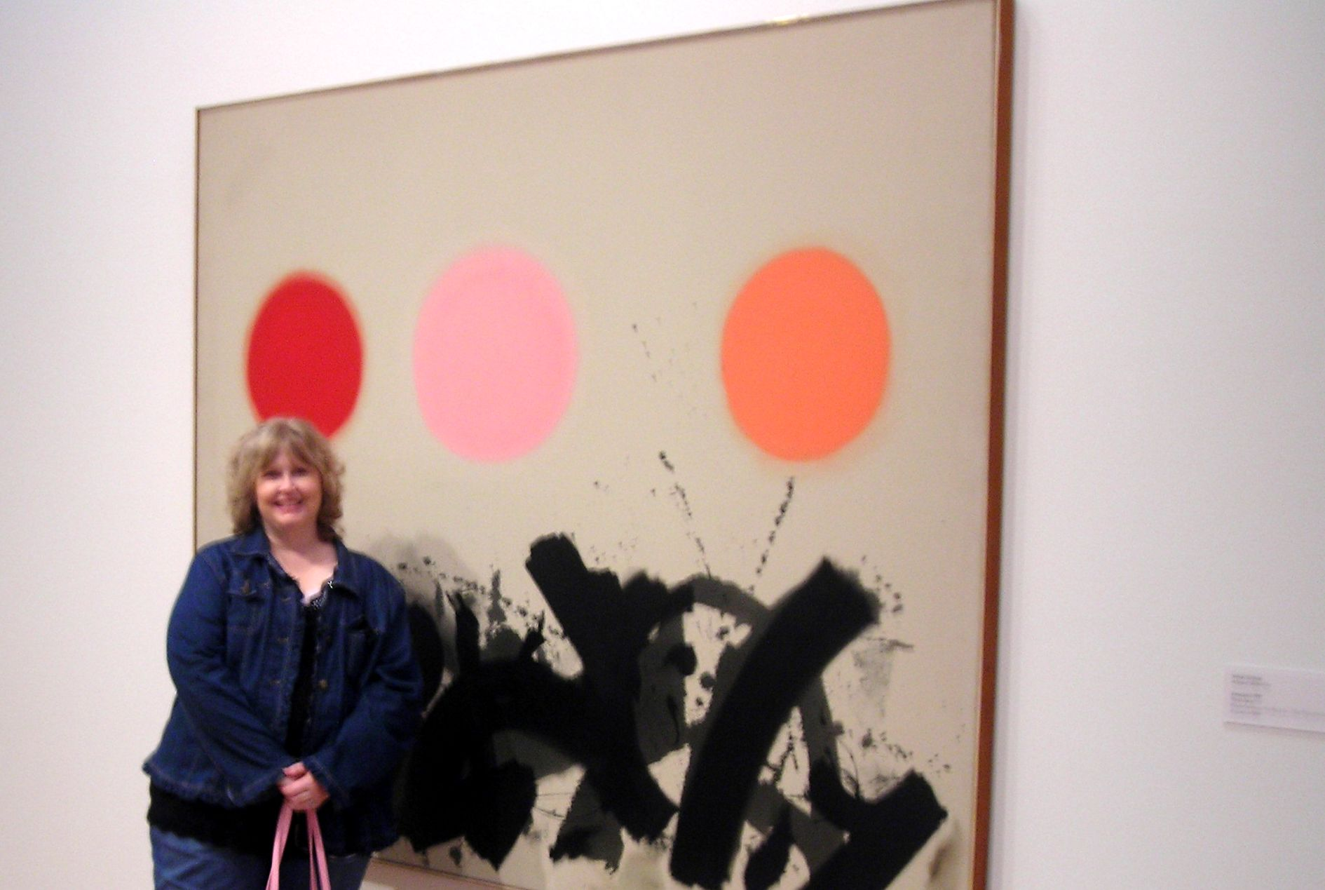 this is art?! okay. at least it has a pink blob on it. oh, and me standing in front of it.