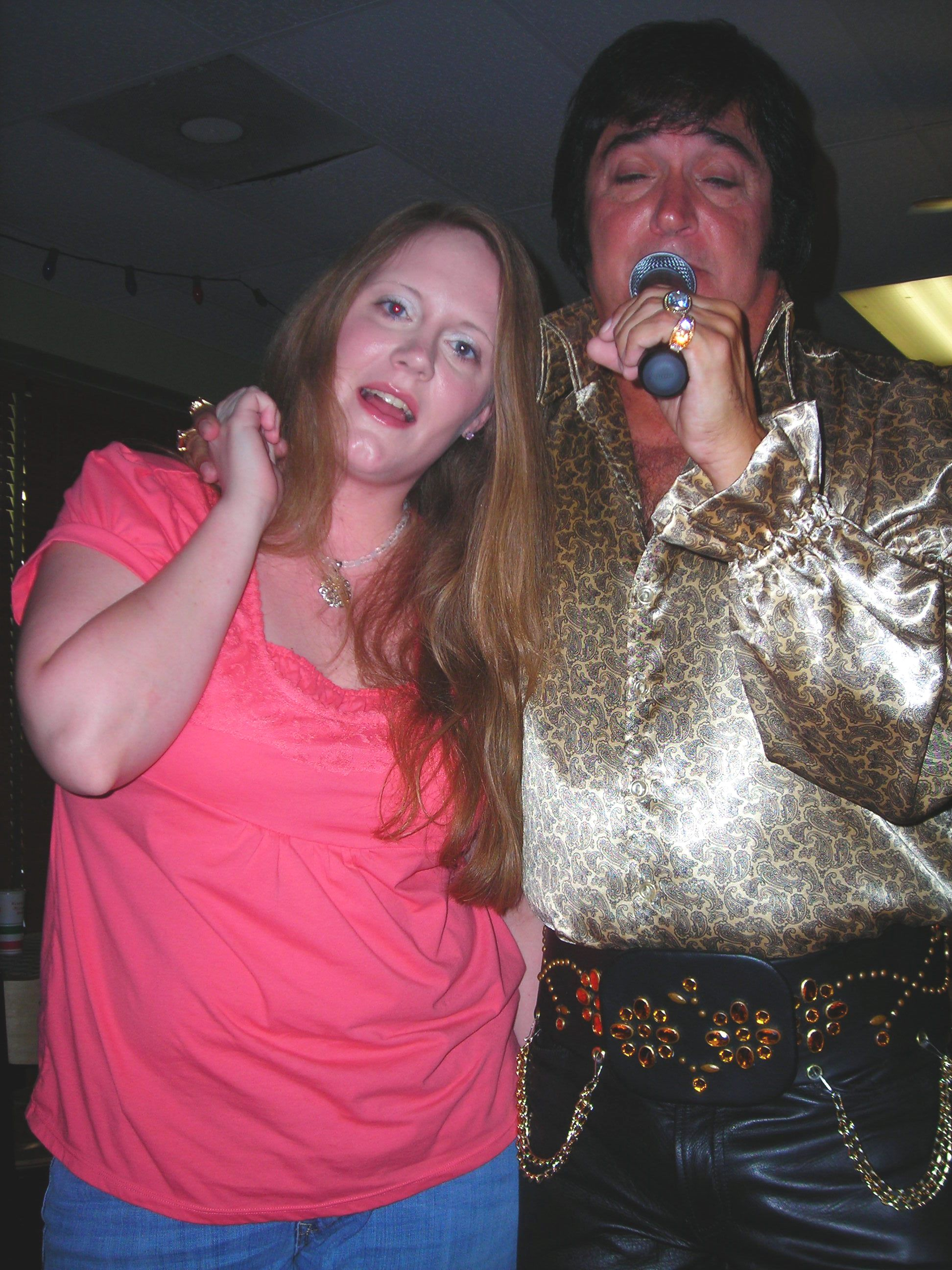 elvis with my baby girl (she's an angel, but the devil in disguise!)