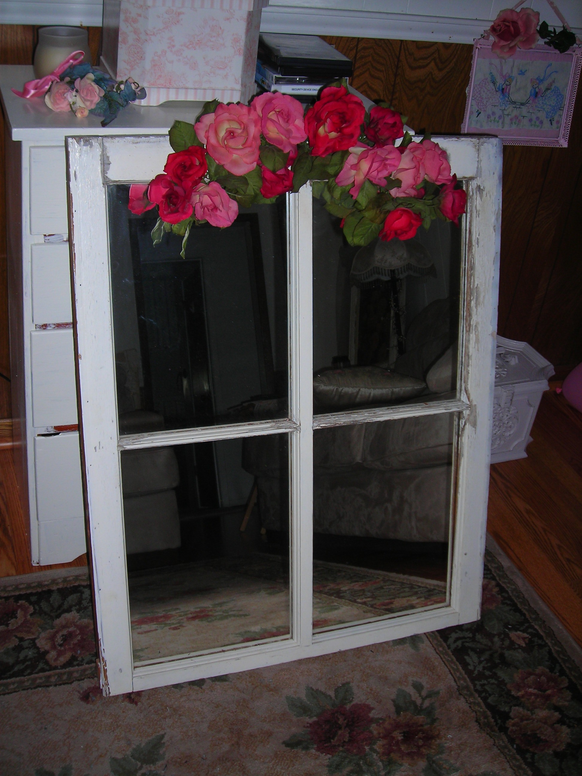 old window frame w/mirror. gonna yank off that swag that came with it and use something else. will be part of my bedroom makeover