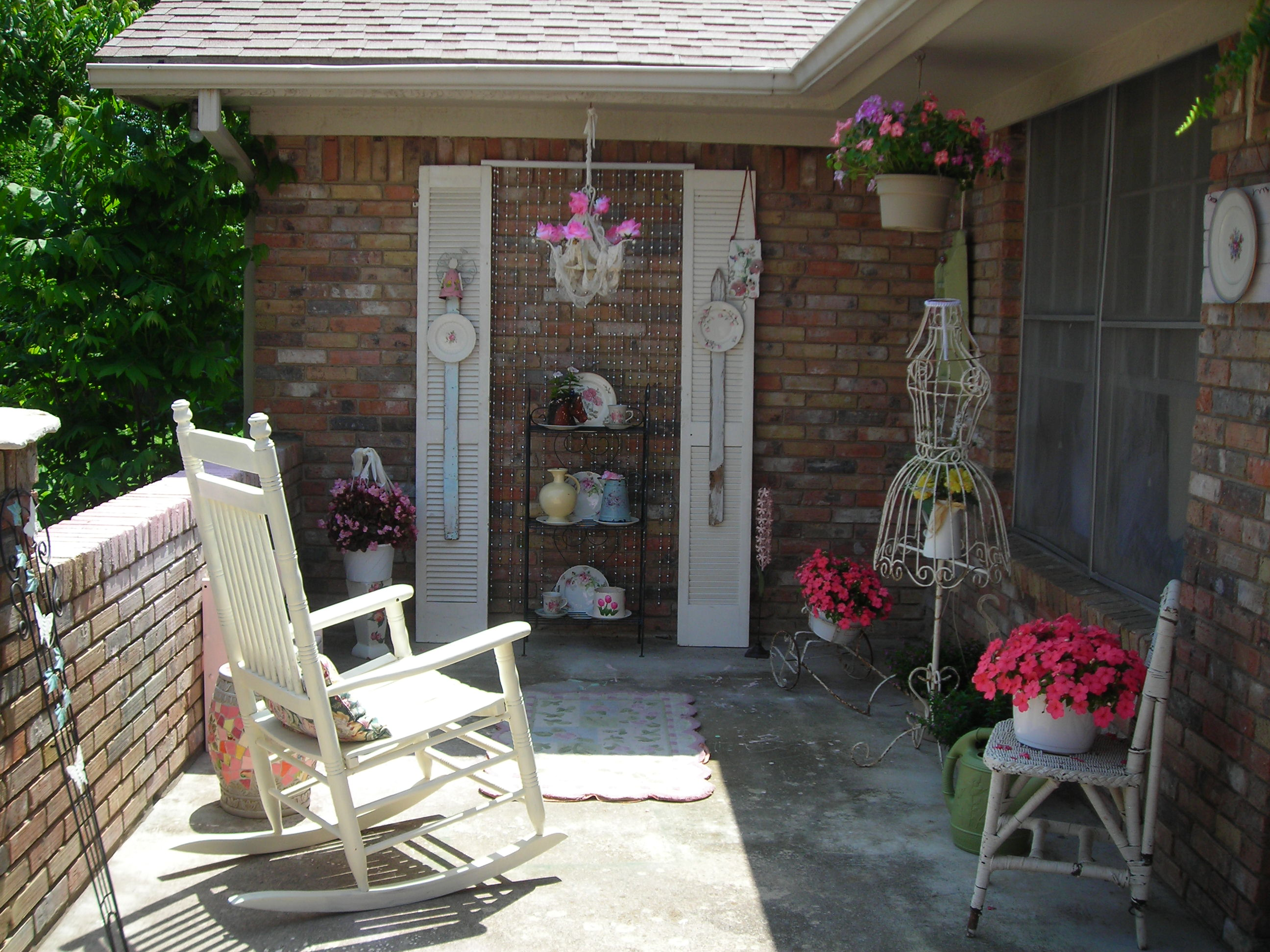 my patio makeover. it used to be verrrrry scary. now it's an outside room! very lovely and inviting. love it!