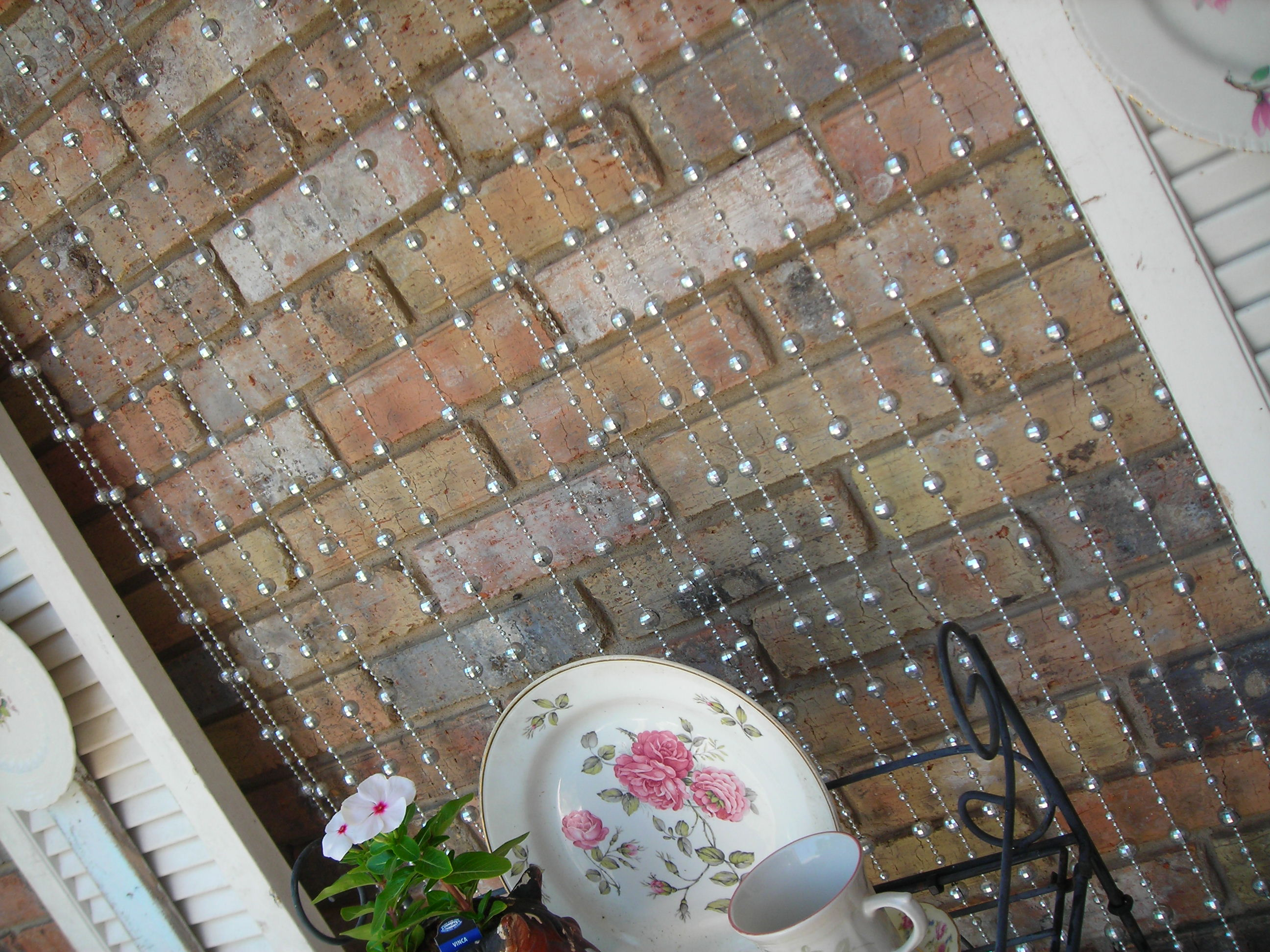 when the wind stirs the beads, it reminds me of raindrops. a perfect place for those silly 70s disco ball beads!
