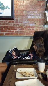 Rhonda's daughter reading The Dark Fae at Groundhouse Coffee