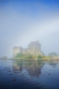 Magical Rainbow, mist and reflection of Eilean Donan Castle in loch