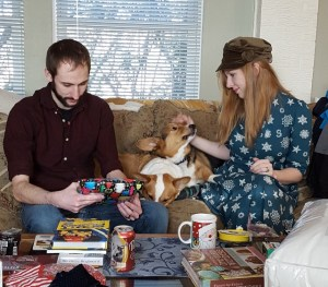 Unwrapping presents with the corgis.