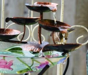baby mockingbird head fountain (640x547)