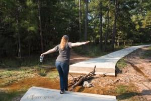 Jenn walking across tree branch 900