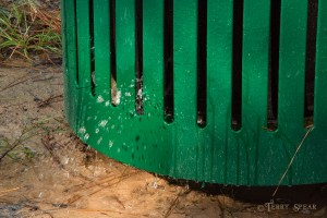 water pouring out of trash receptical 900