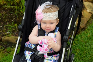 baby with feather headband and flowers 1000 043