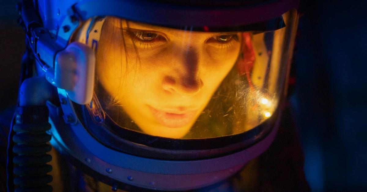 A woman in an oxygen helmet