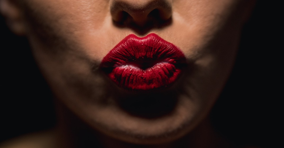 A woman's pair of puckered red lips