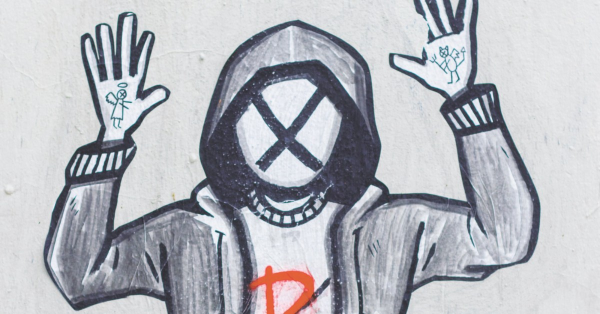 The drawing of a faceless man with an X on his blank face and his hands raised in surrender