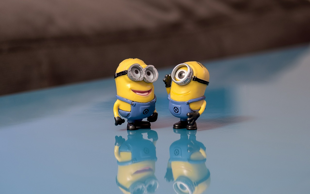 Two minions smiling and talking
