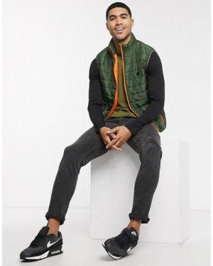 Le Breve high neck gilet in khaki with orange trim-Green