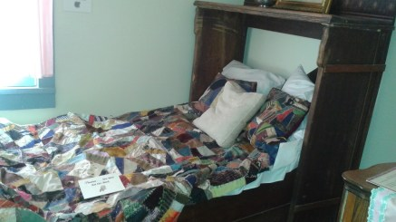 Hotel bed with quilt dated 1890's