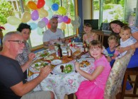 Our family gathers round the table for Dan's birthday