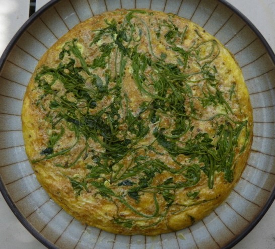 a cooked omlette turned out onto a plate