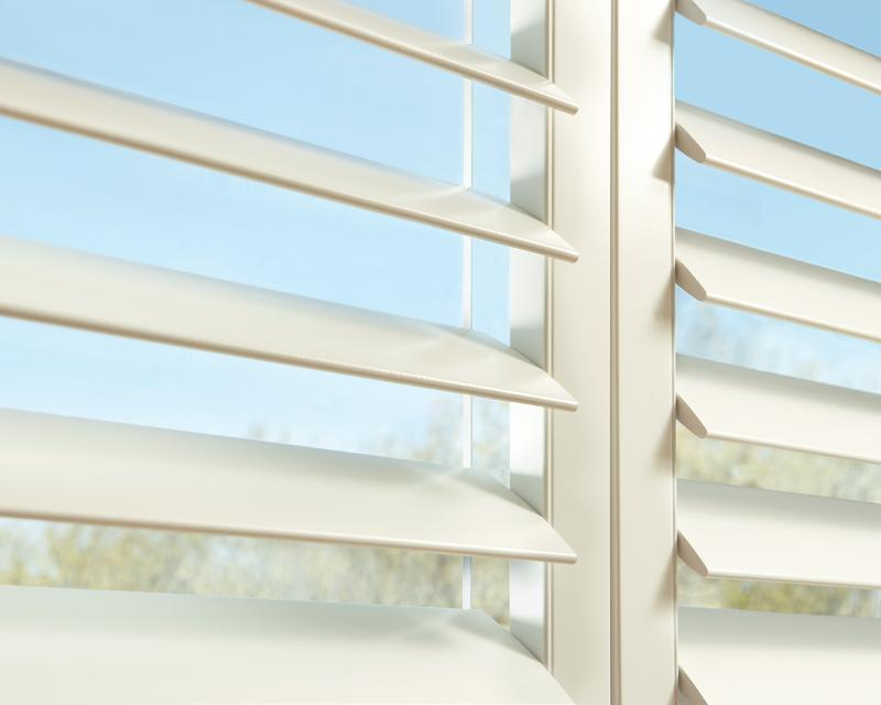 Hunter Douglas NewStyle Shutters with Clearview tilt in Colorado