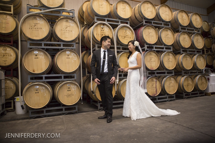 photo of first look in barrel room at Faulkner Winery wedding