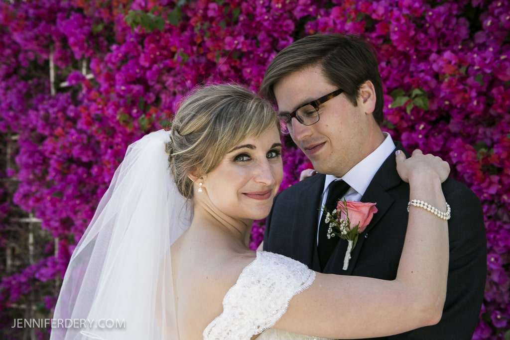 photos of bride and groom in front of dark pink bougainvillea plant backdrop