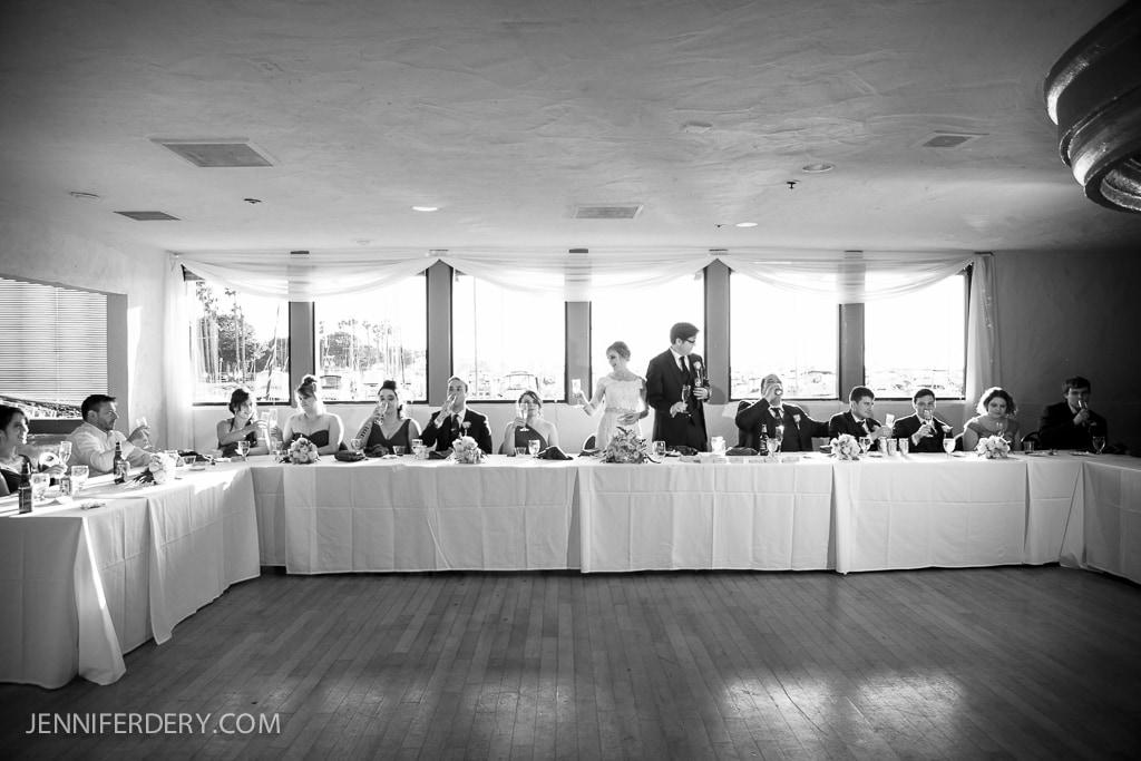 photos of a long bridal party head table