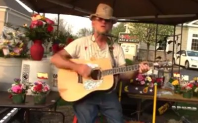 Chris Bihary sings about 45 years at flower stands