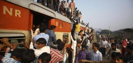commuters-struggle-to-board-a-train-at-noli-railway-station-in-uttar-pradesh