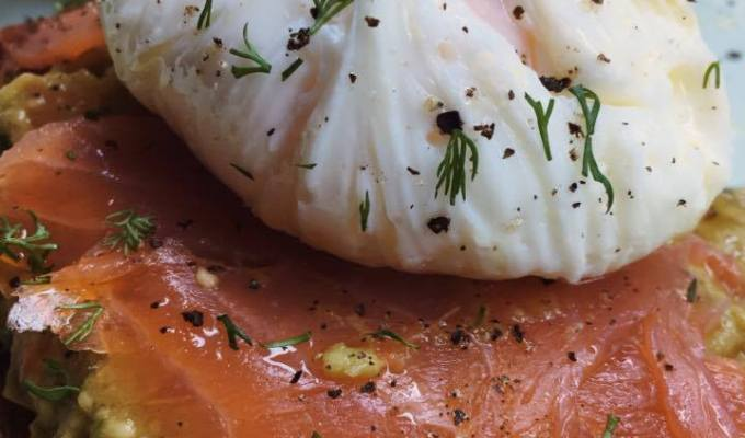 Poached eggs with guacamole dip and smoked salmon