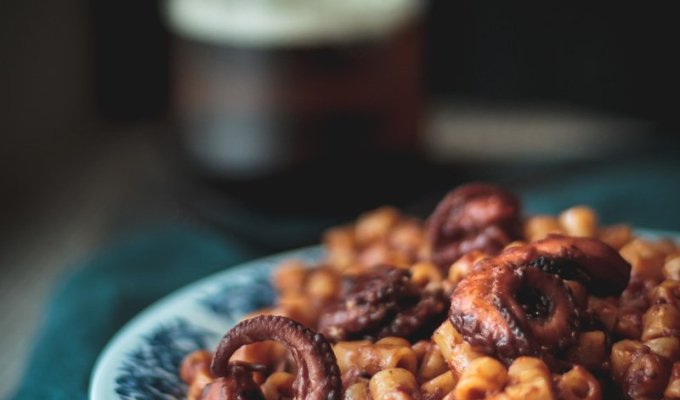 Baby octopus with pasta in tomato sauce
