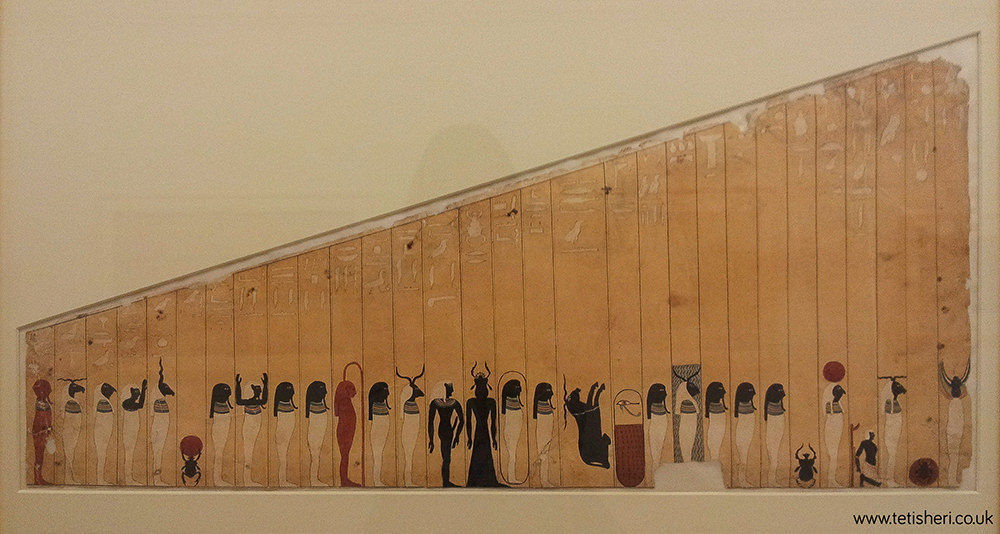 There are many forms of Re, standing in a row. Most are mummiform with black heads, others have animal heads