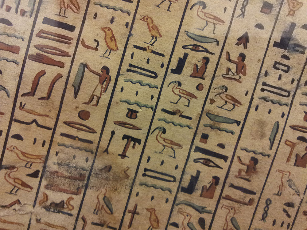 The hieroglyphs are in vertical columns and quite brightly coloured. They sit slightly on a slant; not perfectly vertical