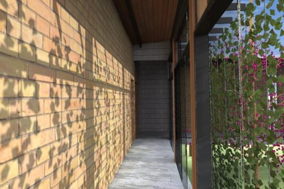 """FACHADA OESTE_CORREDOR DE ACESSO AOS DORMITÓRIOS: detalhe do """"brise vegetal"""" (ou cortina verde) que protege os dormitórios da insolação"""