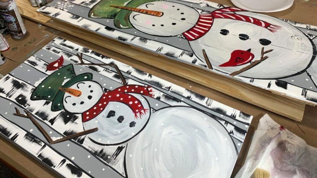 Winter art idea with snowman and birch trees on canvas.