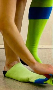 person wearing compression stockings